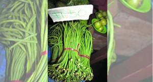 Long bean selling at $1.50 a bundle.