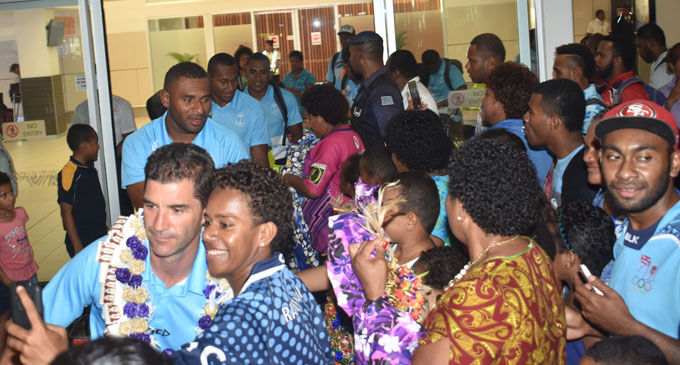 Fiji Airways 7s coach Gareth Baber with fans at the Nadi International Airport on February 5, 2018. Photo: Waisea Nasokia
