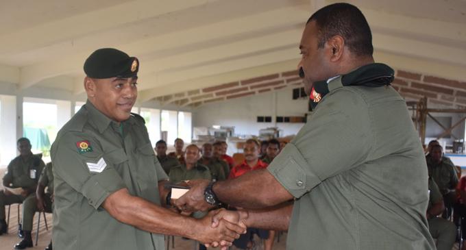 Republic of the Fiji Military Forces Sergeant Lepani Matevakaloloma (left), with Lieutenant-Colonel Patrick Sloan during the farewell at Black Rock in Nadi on February 22, 2018. Photo: Arieta Vakasukawaqa
