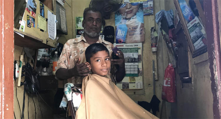 Barber Khan prefers old way