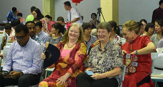Permanent Secretary for the Civil Service and Acting Permanent Secretary for Forestry Bernadette Welch (with fan) and the Permanent Secretary for Education Alison Burchell at the Chinese New Year Celebration at the Yat Sen Hall in Suva on February 11, 2018.  Photo: Lusiana Tuimaisala