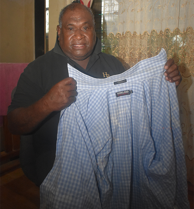 Step-father Mosese Baledrokadroka holds a shirt belonging to Iliesa Tawalo at their residence at Beverly Hills in Votualevu, Nadi on February 26, 2018. Photo: Waisea Nasokia
