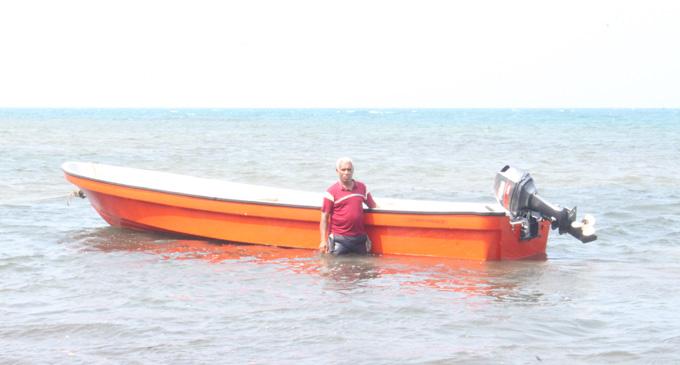 Neori Vakadranu with his boat and engine on Taveuni Island on February 15, 2018. Photo: Wati Talebula