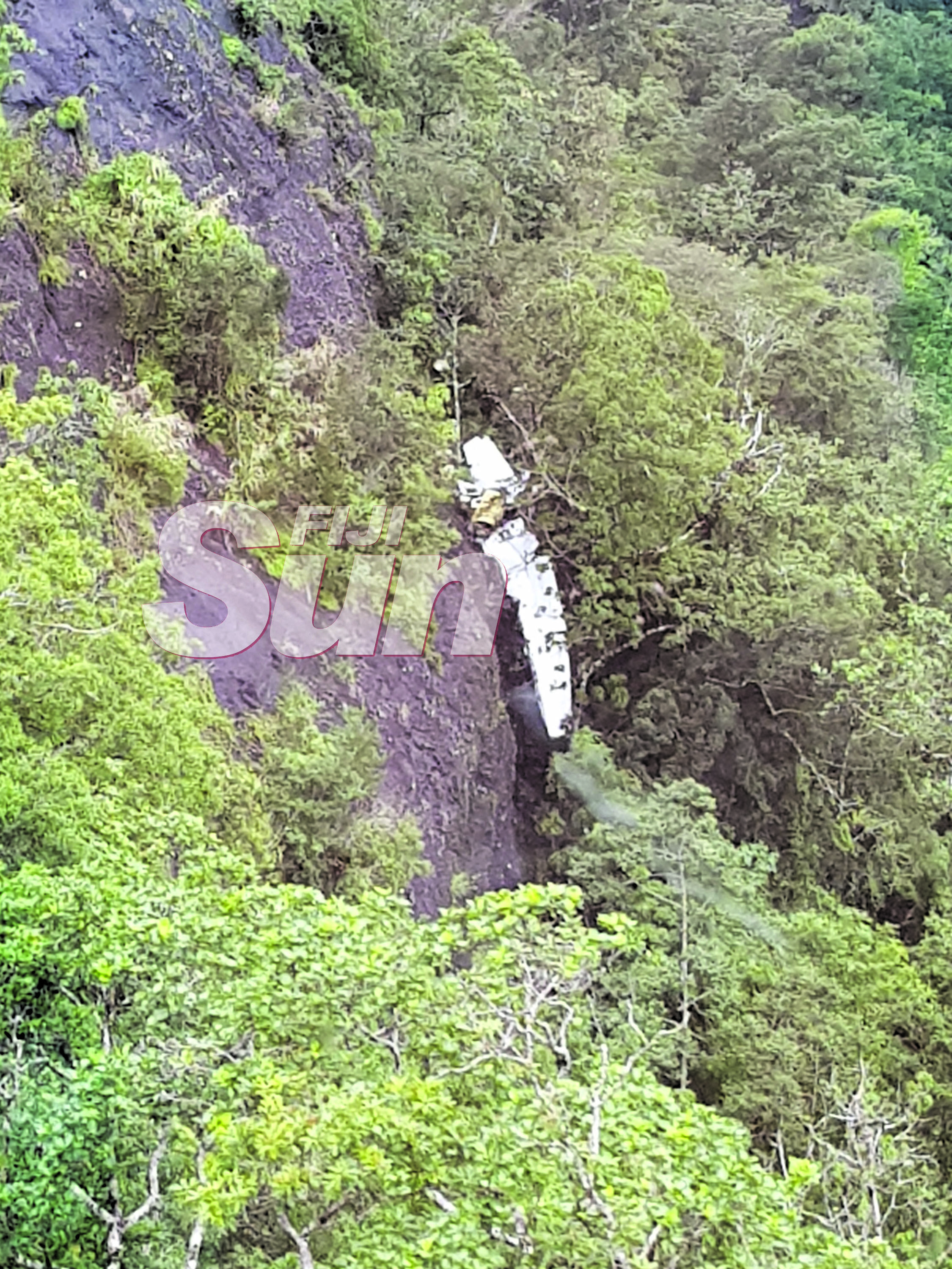 The Cessna 172 aircraft wreckage seen here hanging off a cliff on  the Delaikoro ridge.  Photo: Fiji Rescue Co-ordination Centre