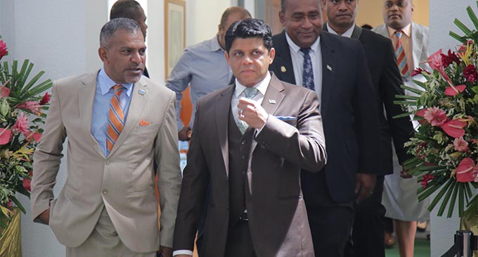 Acting Prime Minister and Attorney-General Aiyaz Sayed-Khaiyum, right, and Minister For Industry, Trade, Tourism , Lands and Mineral Resources Faiyaz Koya during a break in the parliamentary session . Photo: PARLIAMENT OF FIJI.