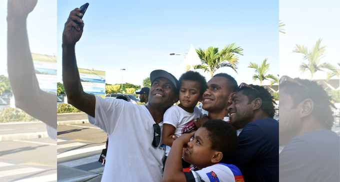 Fiji Airways 7's rep Eroni Sau with relatives at the Nadi International Airport on March 14, 2018. Photo: Waisea Nasokia