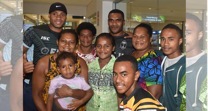 Fiji Airways 7's rep Batinisavu Uluiyata(far left) and Vasikali Mudu with relatives at the Nadi International Airport on March 14, 2018. Photo: Waisea Nasokia