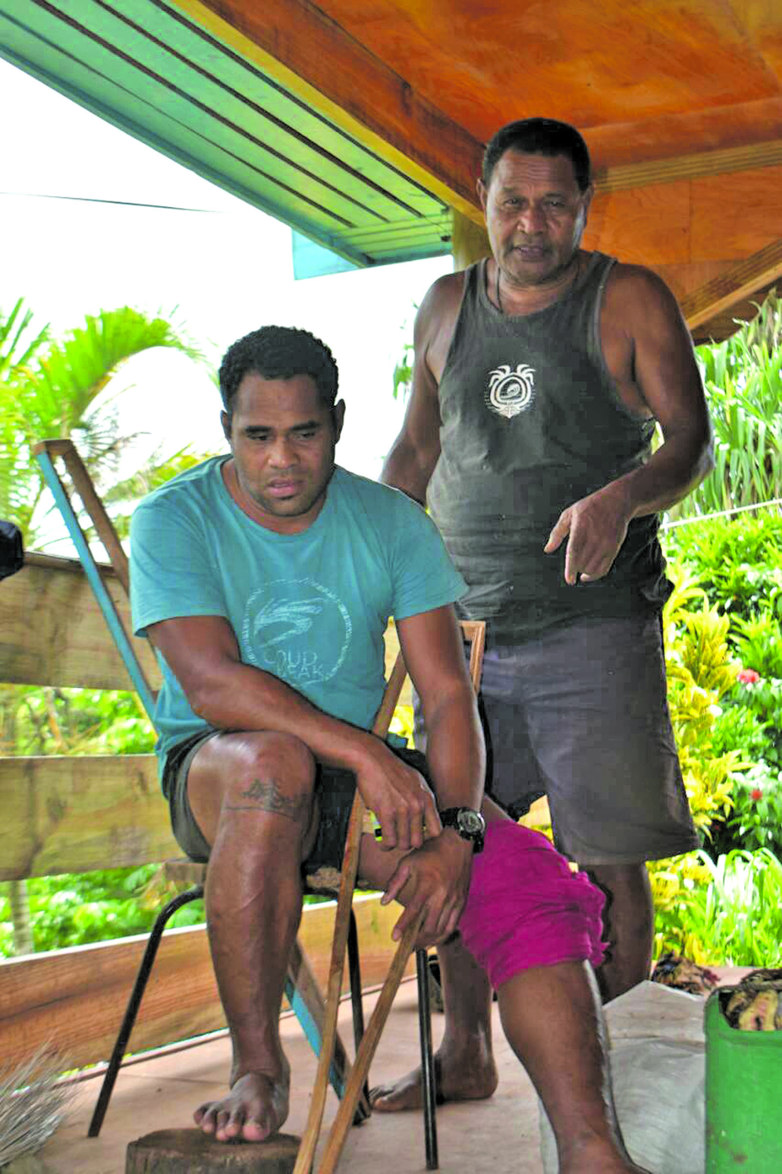Samuela Valekuta with his son Aborosio Rokete who was injured during the search at his home in Dogoru Village on February 28, 2018.  Photo: Wati Talebula