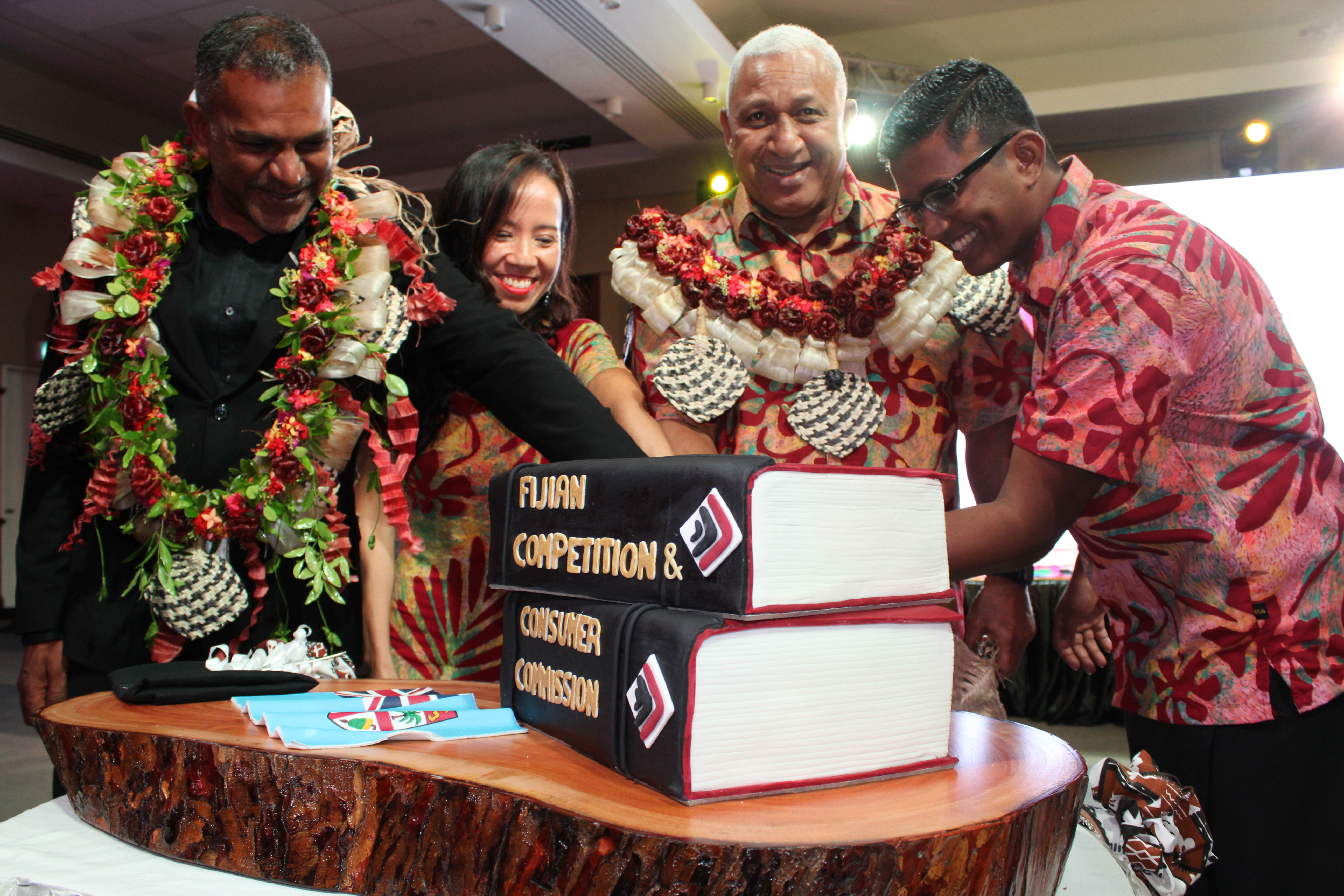 From left, Minister for Industry, Trade and Tourism Faiyaz Koya, Fijian Competition and Consumer Commission chairperson Joann Young, Prime Minister Voreqe Bainimarama and FCCC chief executive officer Joel Abraham during the cake cutting ceremony to mark the launch of FCCC's new branding at the Grand Pacific Hotel in Suva on March 26, 2018.  Photo: Photo: Simione Haravanua
