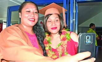 Graduation draws  Tongan sisters together