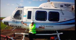 Elite Aviation chief executive officer and founder Alaena Hill with one of her helicopters. Photo: Jason Vargas