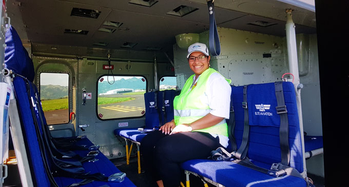Elite Aviaiton chief executive officer and founder Alaena Hill inside one of her helicopters. Photo: Jason Vargas