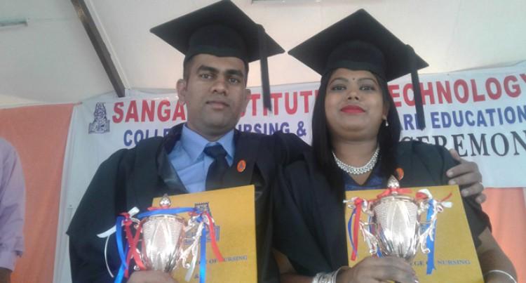 Couple Graduates In Nursing