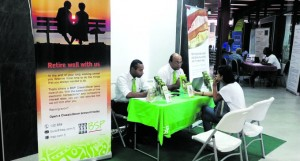Staff members of Bank South Pacific serve a member of the public during the Retirement Expo at the Fiji National Provident Fund Downtown Boulevard in Suva. Photo: Maraia Vula