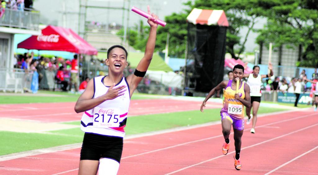 Jessie Vakaloloma of Adi Cakobau School celebrate winning inter-girls 4x1 relay final during Coca-Cola games at ANZ Stadium on April 21, 2018. Photo: Ronald Kumar.