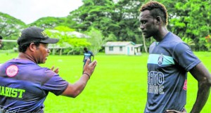 Former Marist FC coach Jerry Allen (left) shows defender Michael Boso what to do as they take on Lautoka tomorrow in the second leg of the OFC Champions League semifinal at Lawason Tama Stadium in Solomon Islands.Photo : OFC Media