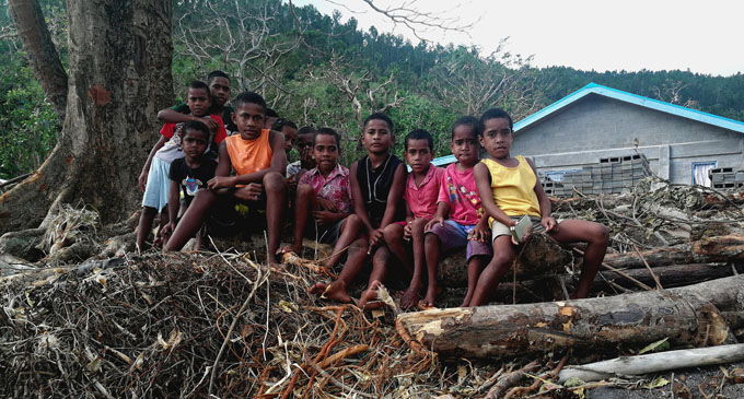 Children of Dagai Village in Kadavu in front of debris left by TC Keni on April 16, 2018. Photo: Arieta Vakasukawaqa