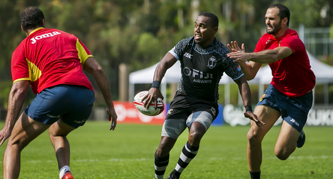 Fiji Airways Fijian 7s squad member Waisea Nacuqu on the attack against Spain in the warm –up on April 3, 2018.  Photo: Kitione Rokomanu/zoomfiji