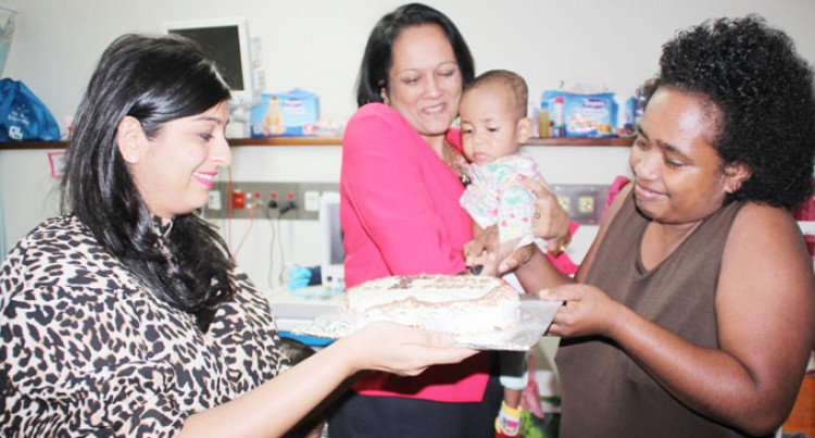 Infant Marks 1st Birthday With Minister