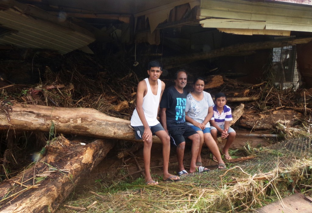 The Kumar family sitting on what is left of their five-bedroom home in Ba, (from left), Devan Kelu, Sanjay Kumar, Ranjana Devi and Veron Kelu, yesterday. Photo: Peni Komaisavai