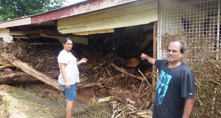 Family Escapes Raging Floodwaters