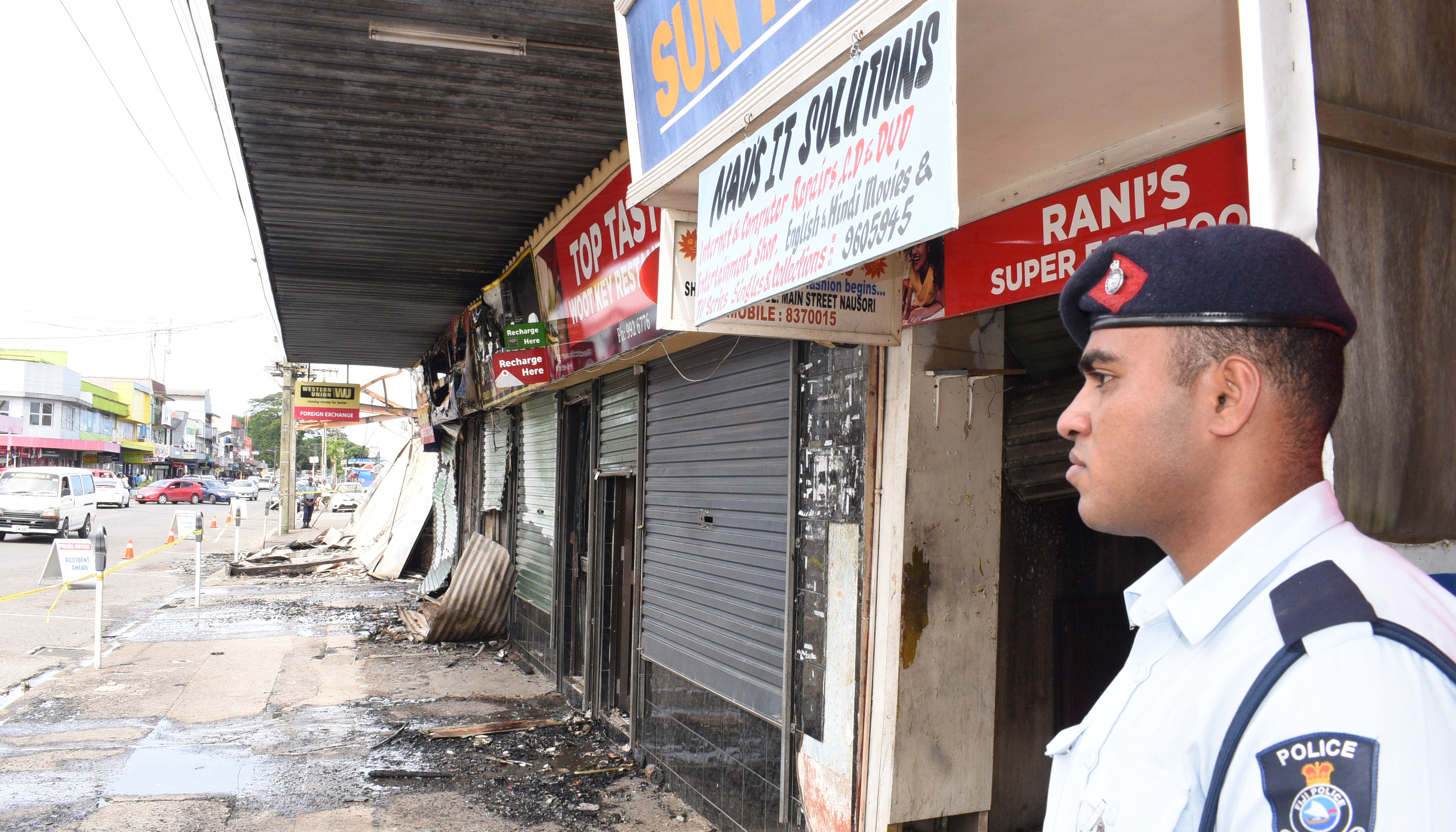 A Police officer keeps watch at the fire scene in Nausori Town on April 17, 2018. Photo: Ronald Kumar