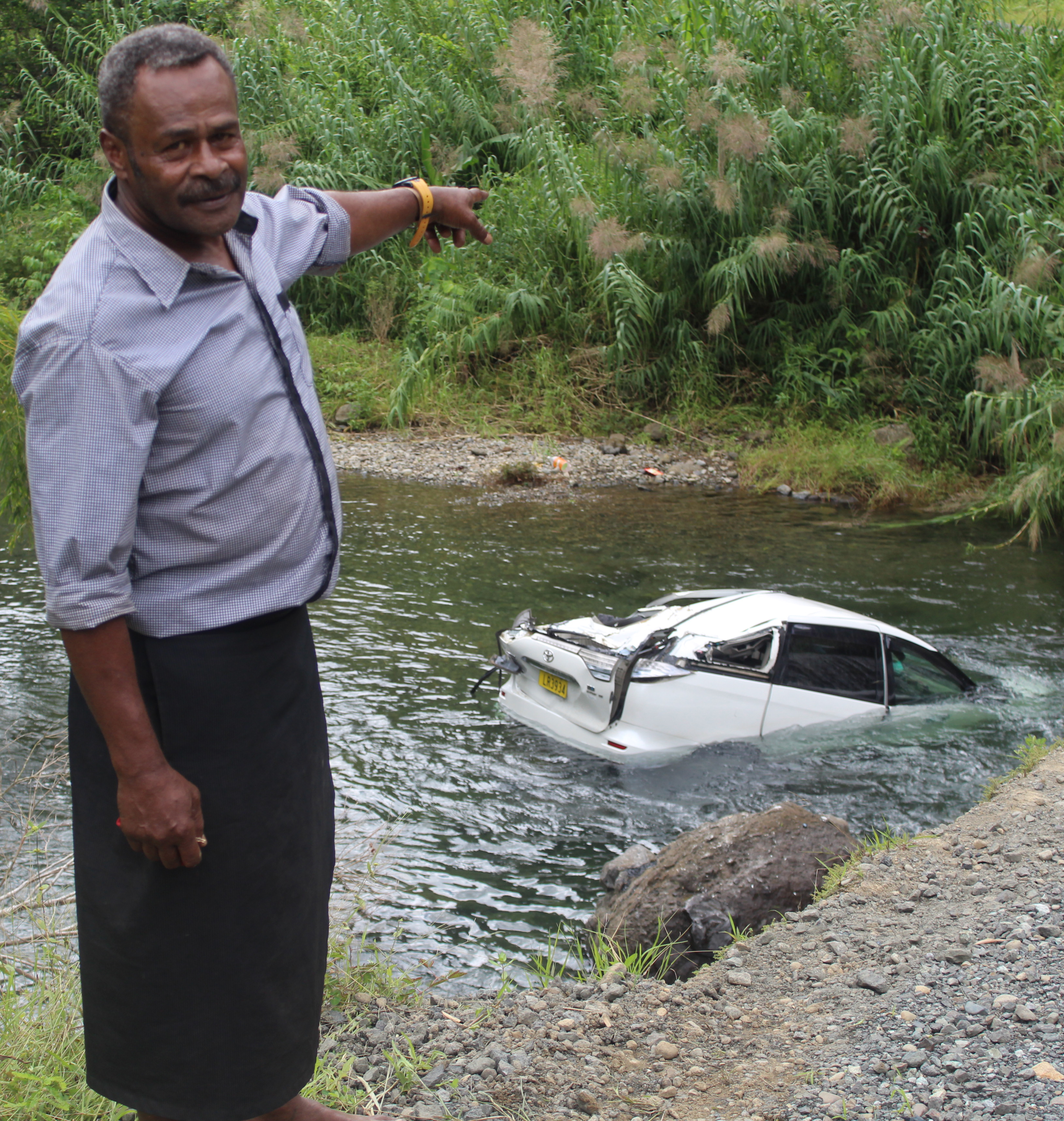 Farasiko Saunivalu points to the car that landed in a river near Namosi Village on April 15, 2018. Photo: Selita Bolanavanua