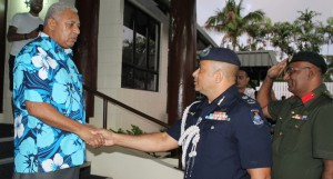 Police Commissioner Sitiveni Qiliho and Bridigier Mohammed Aziz wishing Prime Minister Voreqe Bainimarama good luck during his 64th birthday on April 27, 2018. Photo: Simione Haravanua