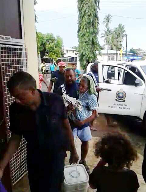 A policeman carries 86 year-old Sereima Divavani to the evacuation centre at Shiri Guru Nanak Khalsa College in Labasa. Photo: Wati Talebula