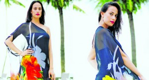 A model wearing a dress designed by Zelda Thomas.