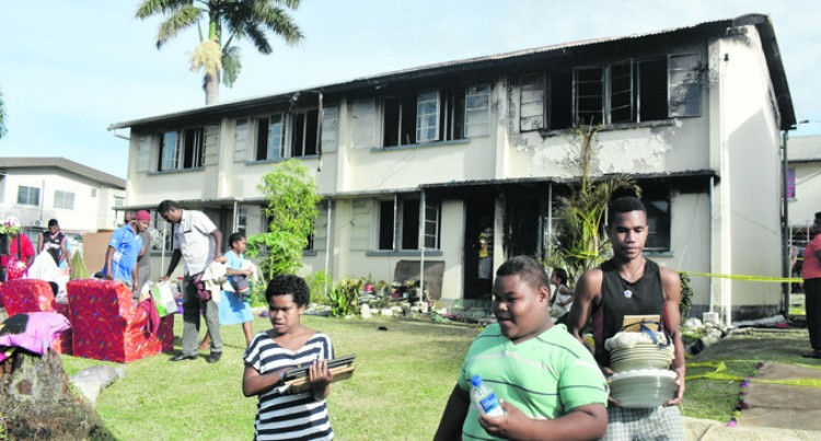 Woman, 50, Flees Fire In Time