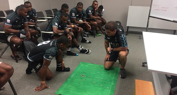 Fiji Airways Fijian 7s playmaker Vatemo Ravouvou works out their moves as Gareth Baber and the players look on. Photo: FRU Media