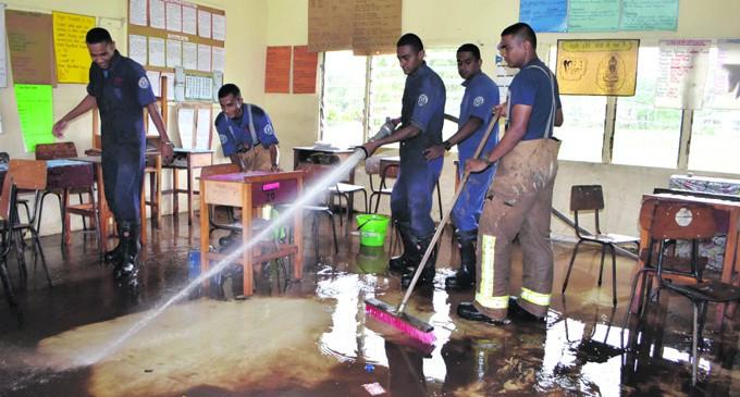 Firefighters Clear School Debris