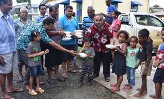 Group Distributes Food To Evacuees