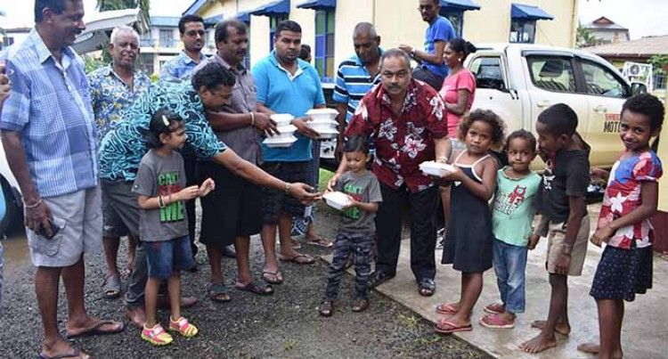 Group Distributes Food To Evacuees