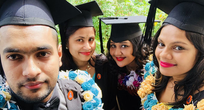From left: Salvindra Nitesh, Romika Nand, Shiva Sital Devi and Shiwagani Mudialar after graduating from the Sangam College of Nursing on April 18, 2018.