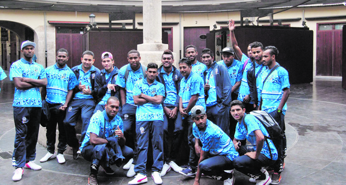 Filipe Baravilala standing(second from left) with members of the Fiji football team. Photo: Fiji FA