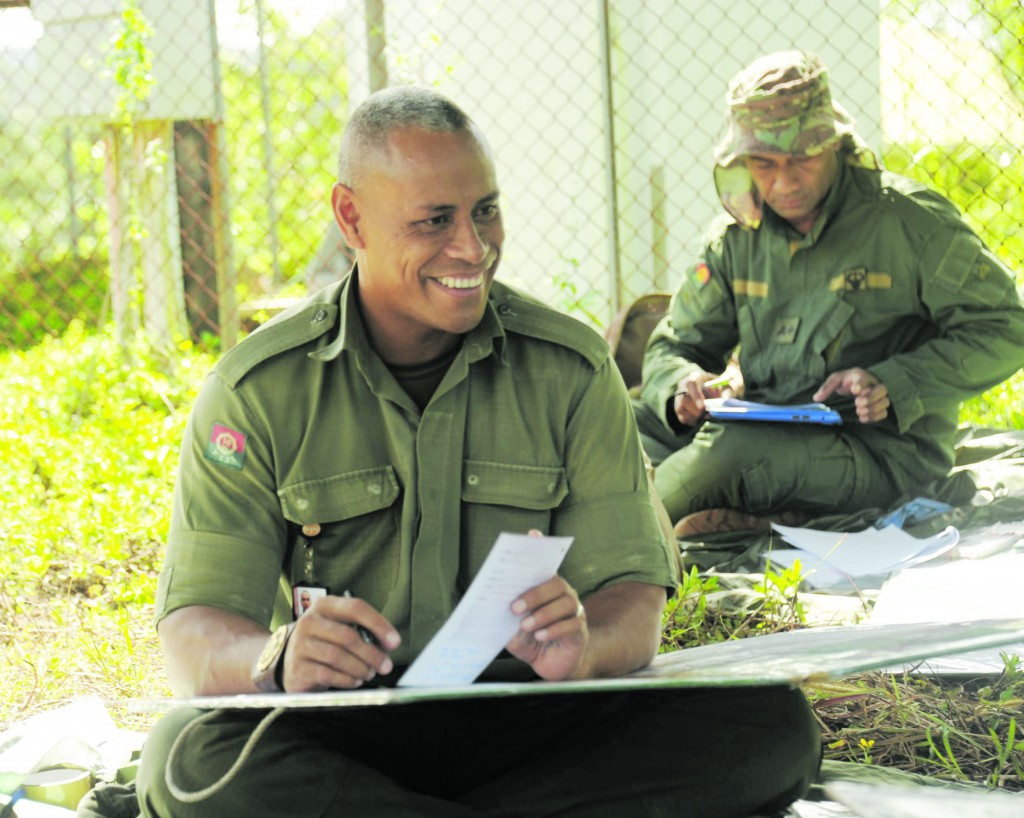 Top: Warrant Officer Class 2 Waqabaca shares his battle plan during an exercise at Nabukavesi . Inset: WO2 Varea enjoys a light moment with his comrades. during the Regimental Sergeant Major 1/18 course on May 9, 2018. Photo: RFMF Media Cell
