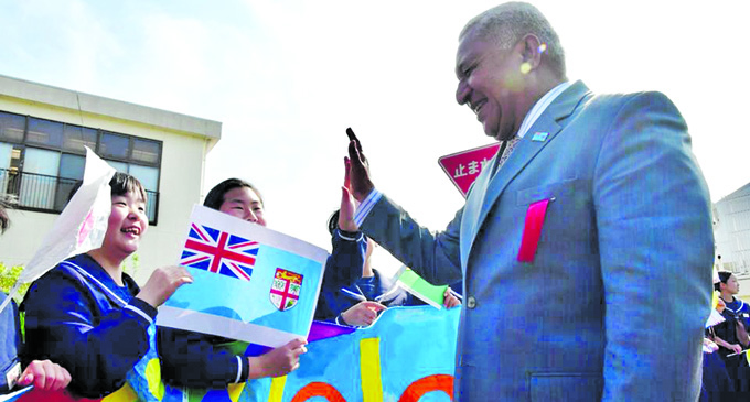 Prime Minister Voreqe Bainimarama in Japan meeting the public and Japanese children. Photos: DEPTFO News