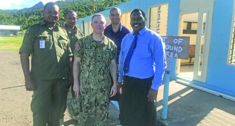 Embassy Team Inspects School Damage