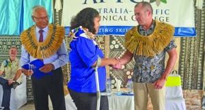 Australian High Commissioner, John Feakes congratulates Elenoa Kaisau, Certificate IV in Disability programme graduate