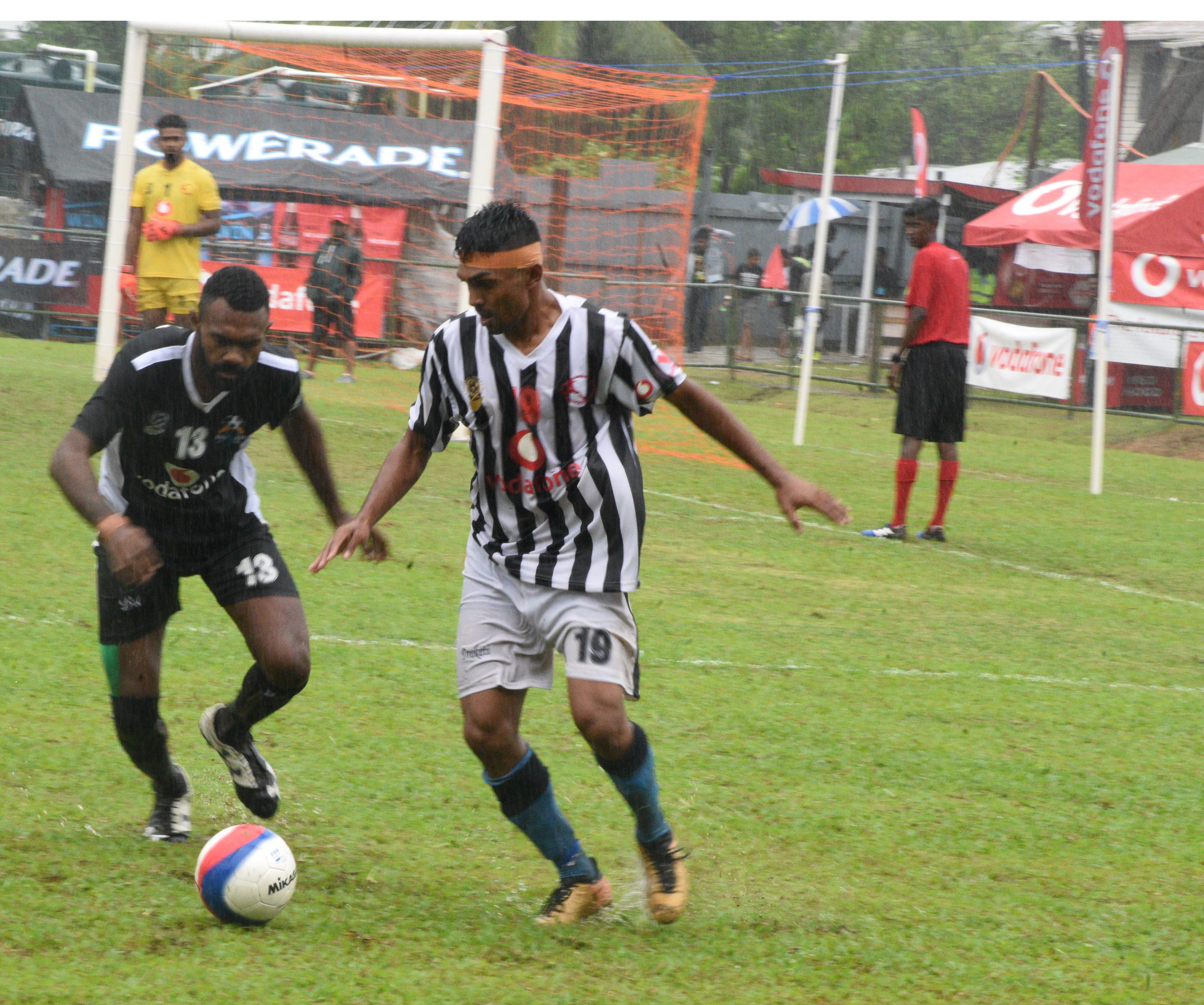 Mohammed Yaseen of Dreketi shields the ball away from Malakai of Ba during the Vodafone Fiji FACT at Ratu Cakobau Park, Nausori on May 27, 2018.  Photo: Simione Haravanua