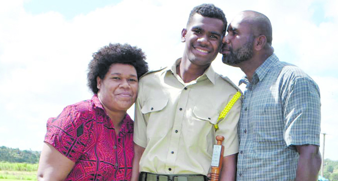 All Saints Secondary School Best Male Cadet Kepu Mairata with his parents after the pass out parade in Labasa on May 11, 2018. Photo: Wati Talebula
