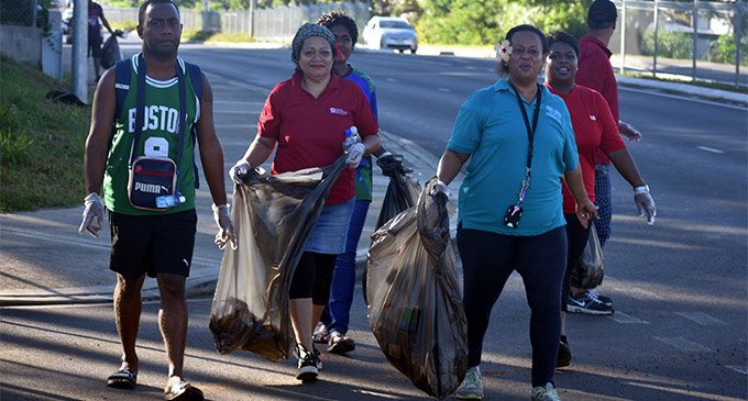 Luisa Tigarea (front, right) leads her team during the clean-up campaign in Namaka on May 5, 2018.  Photo: Waisea Nasokia