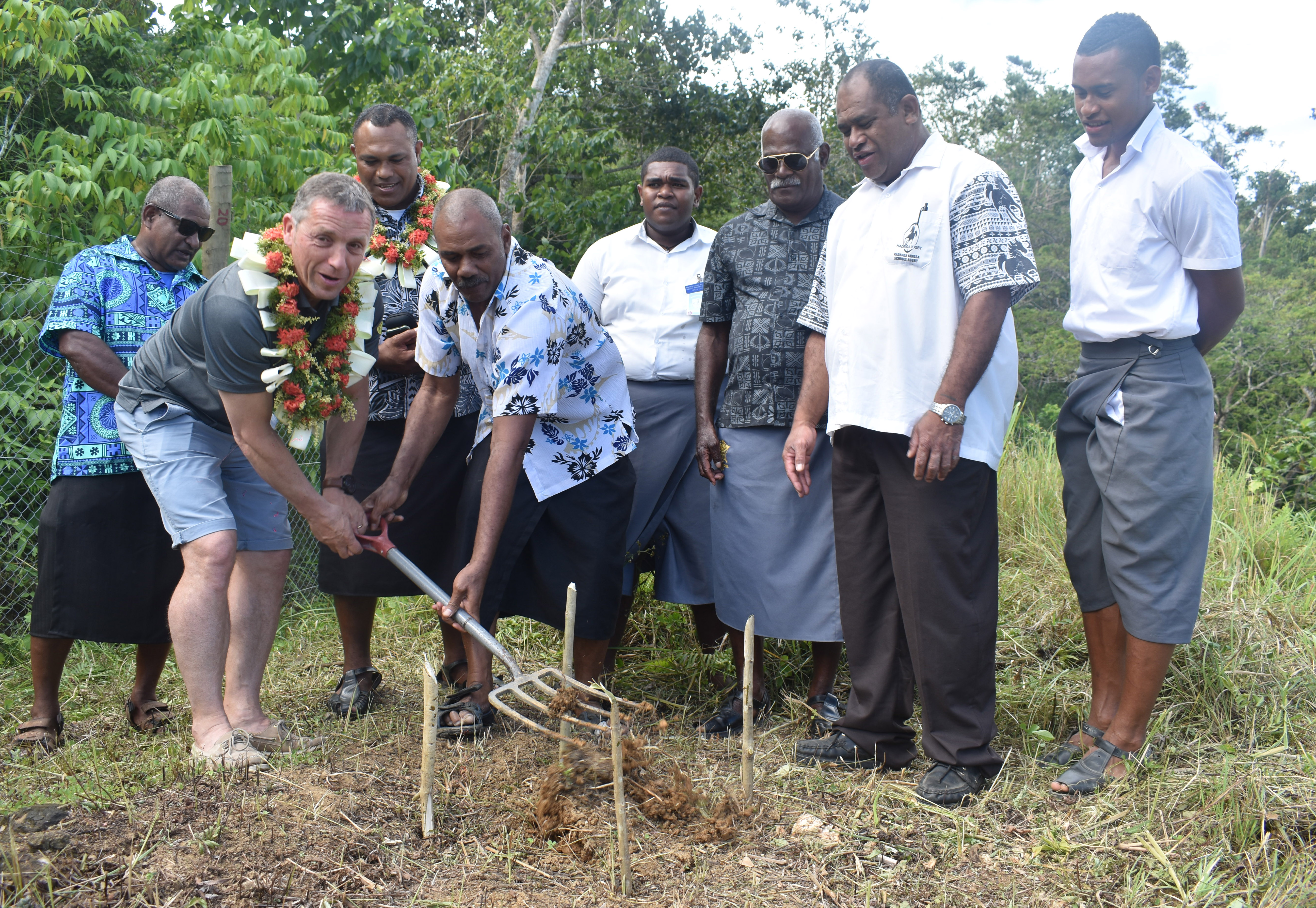 ASM Clermont Rugby Academy Director Bertrand Rioux (with garland) with Taukei Nahehevia Nemani Naitonicagi  officiate the borehole project at the Sigatoka Valley High School in Nadroga on May9 ,2018. Photo: Waisea Nasokia