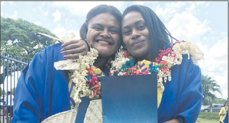 Best Friends Show Joy On Graduation Day