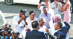 Fiji Times Limited lawyer Wylie Clarke and lawyer Nicholas Barnes celebrate with Publisher Hank Arts and Editor-in-Chief Fred Wesley High and some staff members outside court on May 22, 2018. Photo: Ronald Kumar