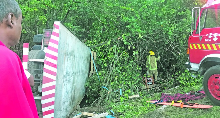Truck Overturns, Driver In Hospital