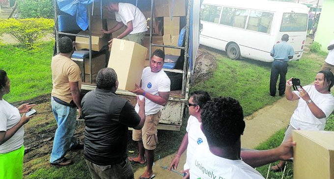 Government officials from the Ministry of Industry, Trade and Tourism and Lands and Mineral Resources distributing cartons of relief at Votua Village in Ba on May 5, 2018. Photo: Arieta Vakasukawaqa