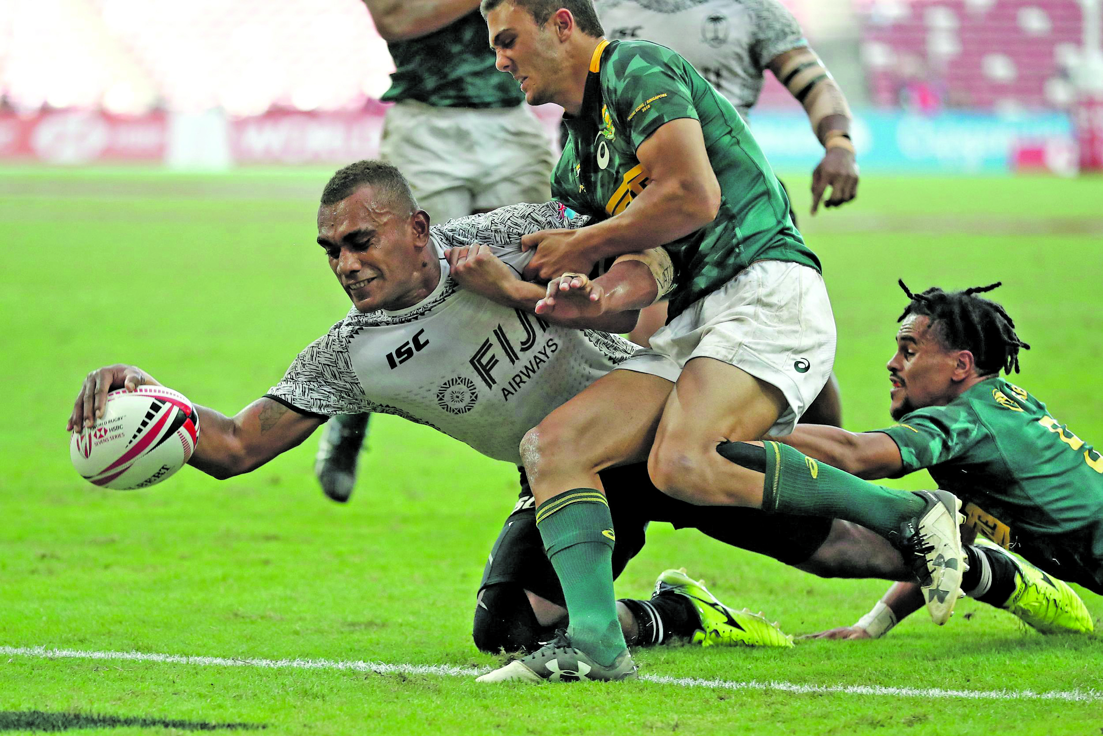 Eroni Sau reaches out for a try against South Africa on day two of the HSBC World Rugby Sevens Series in Singapore on April 29, 2018.  Photo: World Rugby